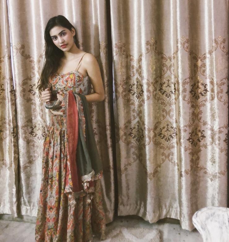 Model wearing ethnic wear from Ritu Kumar.